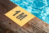Designation of the swimming pool depth of 1 meter on a wooden floor — Stok fotoğraf