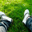 Concept photo of resting. Men's feet in sneakers and Sport Pants — Stock Photo