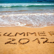 Inscription on wet sand Summer 2012 — Stock Photo