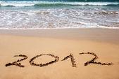 新的一年 2012年砂湿金色海滩上 — 图库照片