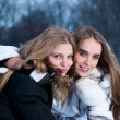 Stock Photo: Two smiling girls in the winter forest