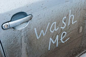 Inscription wash me in the car door — Stock Photo