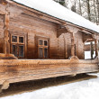 Stock Photo: Old wooden house in winter forest