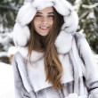 Close-up portrait of beautiful smiling girl in winter — Stock Photo