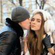 Young couple kissing winter outdoors portrait — Stock Photo