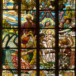 Stained glass window in old church with four saints person praying — Stok fotoğraf