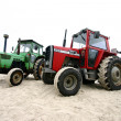 Tractor on a beach - Stock Photo
