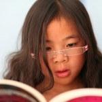 Постер, плакат: Child reading