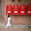 Girl and postboxes - Stock Photo