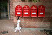 Girl and postboxes — Stock Photo
