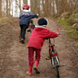 Children with bike — Stock Photo