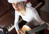 Playing guitar — Stock fotografie