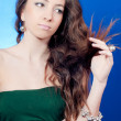 Young beautiful woman looking at her split hair — Stock Photo #10163079