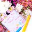 Happy mother day card among flowers — Stock Photo