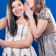 Happy teen friends sharing secret — Lizenzfreies Foto