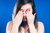 Young woman looking shy — Stock Photo
