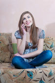 Young beautiful woman talking on cell phone — Stock Photo