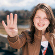 Girl showing four fingers — Stock Photo