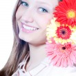 Young girl with gerbera — Stock Photo