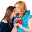 Loving mother and daughter with flowers — Stock Photo #10386784