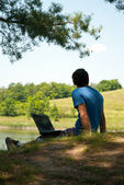 Man with notebook in nature — Stock Photo