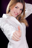 Young woman showing thumb up — Stock Photo
