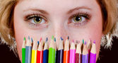Beautiful young girl with colorful pencils — Foto Stock