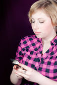 Beautiful woman with cell phone — Stock Photo