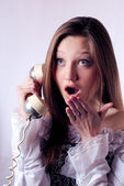 Beautiful girl talking on the phone — Stok fotoğraf