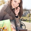 Woman talking on the cell phone — Stock Photo