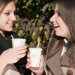Two beautiful young girls drinking coffee — Stock Photo #10413963