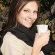 Beautiful young girl drinking coffee — Stock Photo