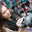 Beautiful young girl buying bra — Stockfoto #10417745