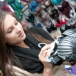 Стоковое фото: Beautiful young girl buying bra