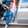 Stock Photo: Young beautiful girl in car