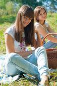 Two happy girls on having picknic — Stock Photo