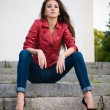Young fashion girl sitting on stairs — Stock Photo #10441010