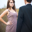 Royalty-Free Stock Photo: Woman looking offended over man shoulder