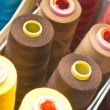 Foto Stock: Colorful spools of yarn