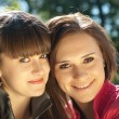 Two happy young women headshot — Stock Photo