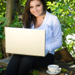 Young woman with laptop distance learning — Stock Photo
