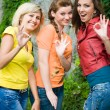 Three smiling women showing okay — Stockfoto