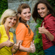 Three smiling women showing okay — Stock Photo