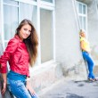 Three happy girls wearing jeans — Stock Photo