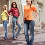 Three happy girls wearing jeans — Stock Photo