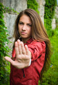 Young girl showing stop sign — Stock Photo
