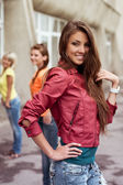 Happy longhaired girl with friends — Stock Photo