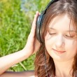 Girl listening to music in headphones — Stock Photo