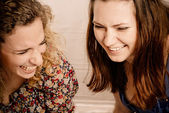 Two girl friends laughing gleefully — Stock Photo