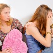 Young teenage girl comforting her friend — Stock Photo